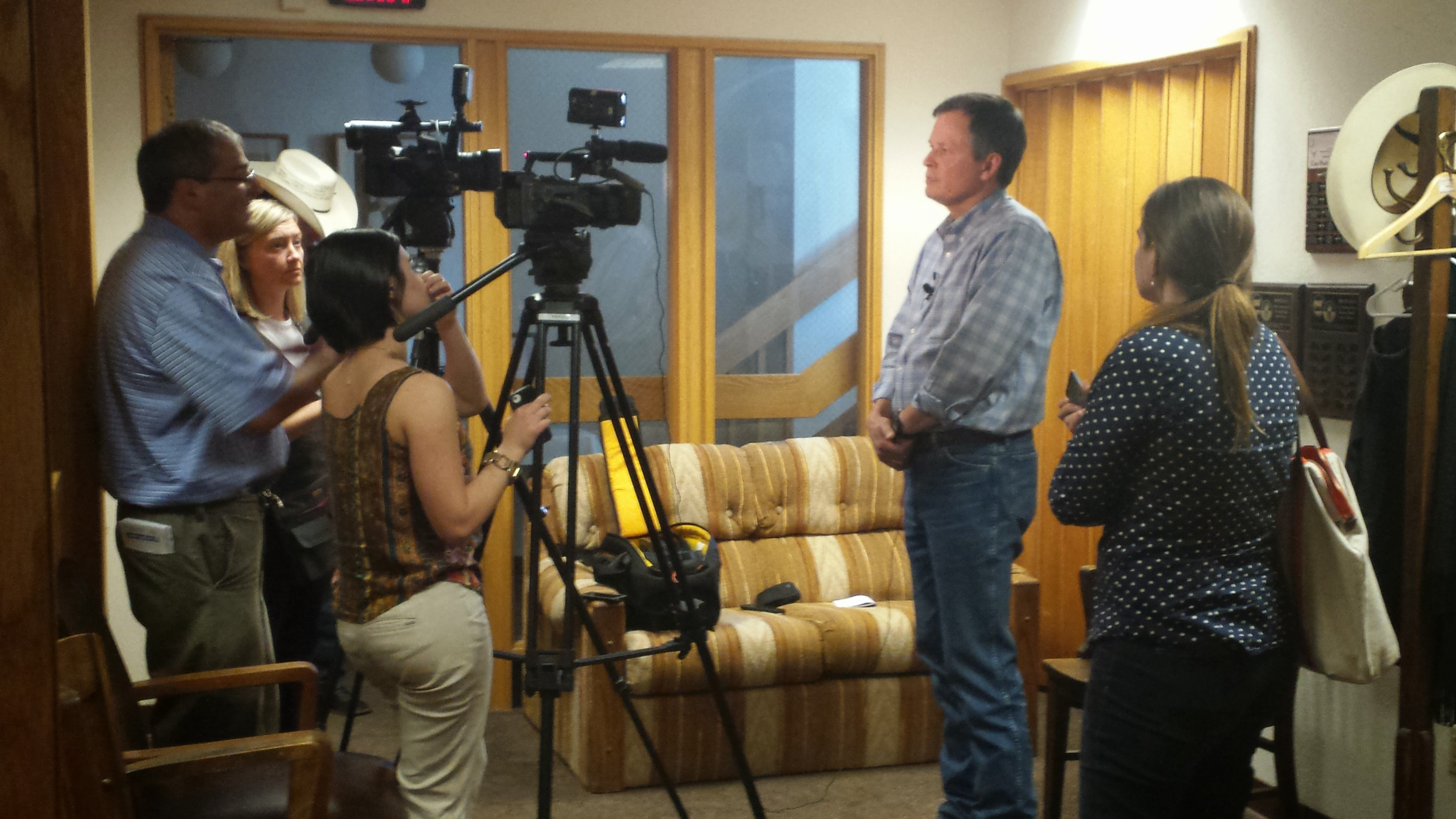 Congressman Steve Daines answers questions from local television reporters prior to a meeting with Montana agricultural groups at the Stockgrowers office on August 7, 2014